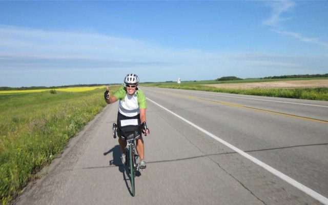 Tour du Canada cyclist on the prairies